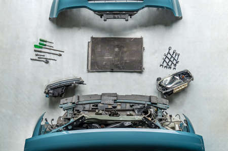 Check for damaged cars at the repair station ,Damaged car parts