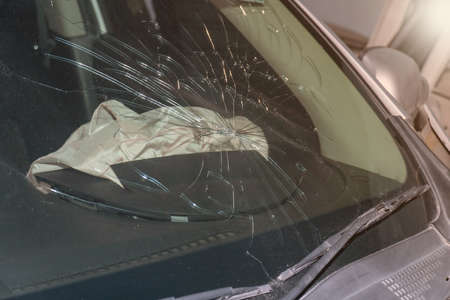 Car of accident make front windshield cracked and airbag explosion damaged Фото со стока