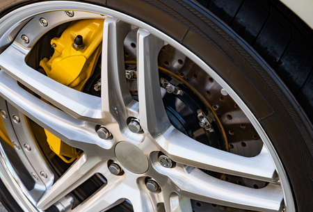 The brake system of a sport car,Car wheel - Close up of rims from a sports car , Part of modern new wheel car with disk brake pad