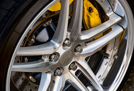 The brake system of a sport car,Car wheel - Close up of rims from a sports car , Part of modern new wheel car with disk brake pad Stockfoto