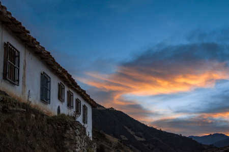 rural house with beautiful view on the mountain at sunset 版權商用圖片