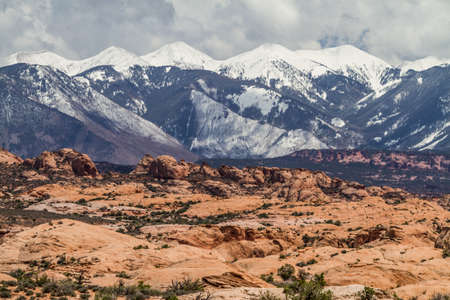 snowy mountains at the bottom of the desert, arches national park