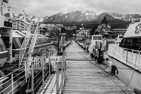 pier of ashuaia bay black and white