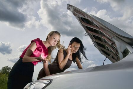 Two young women and trouble with car. Stock Photo - 7200413