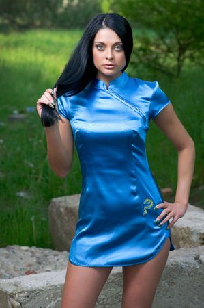 Young sensual woman in a blue short dress photo