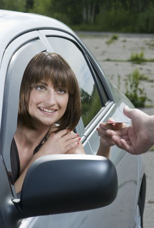 parking ticket: Woman driver shows her license to a police officer