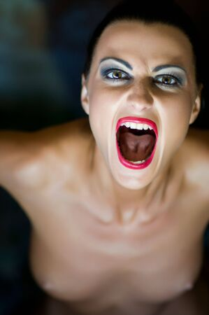 A woman screaming with crazy expression  Stock Photo - 7318394