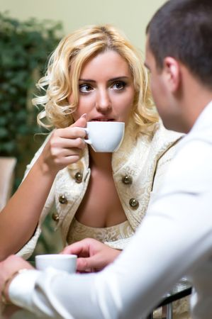 acquaintance: Young couple drinking coffee in a restaurant Stock Photo