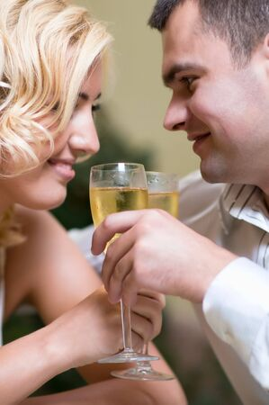 Cheerful young couple drinking champagne in a restaurant photo