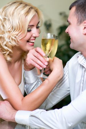 Young couple toasting with champagne and looking at each other  photo