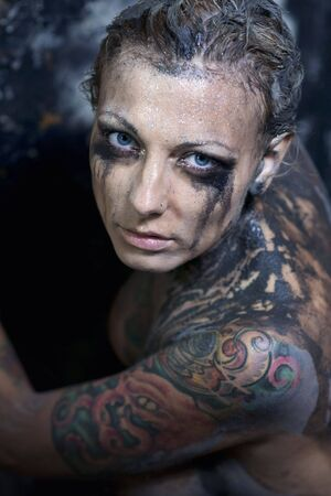 Tattooed young  woman photo