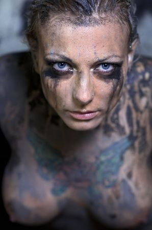 Tattooed naked young woman photo
