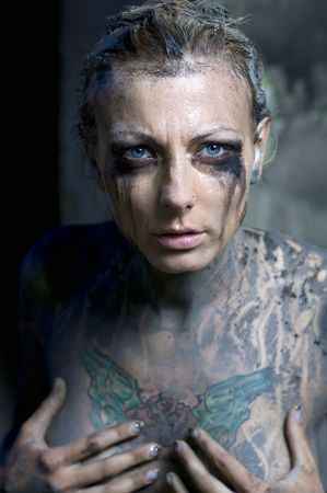 Naked tattooed woman with smeared makeup and dirty body Stock Photo - 7413064