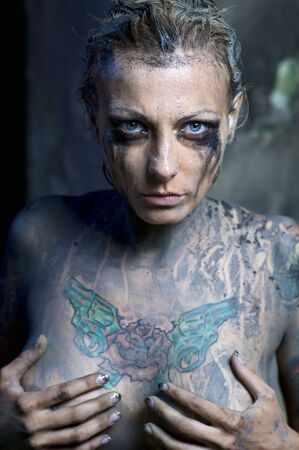 Tattooed young naked woman Stock Photo - 7413070