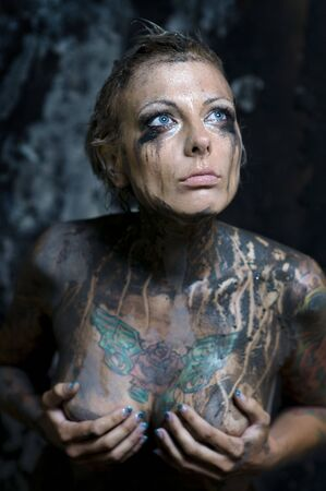 Pretty young woman with many tattoos on her breast and arms  Stock Photo - 7413077