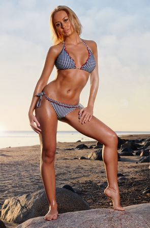 Young beautiful woman posing on the beach  photo