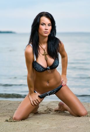 Young beautiful girl relaxing on the beach