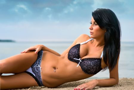 Beautiful young woman relaxing on the beach photo