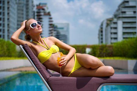 Beautiful girl relaxing in the swimming pool photo