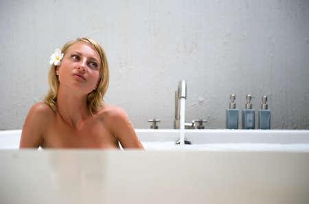 Beautiful young woman enjoying the bubble bath photo