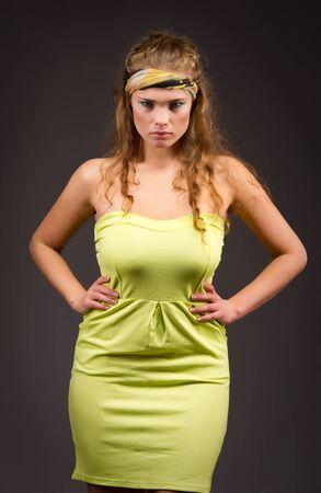 Elegant beautiful woman in fashion dress posing photo