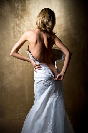 Lovely sensual bride unzip her wedding dress Stock Photo - 8610116