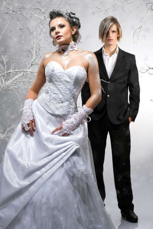 Beautiful bride and groom isolated on winter background Stock Photo - 8610118
