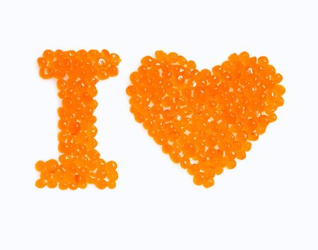 I love you. Red caviar isolated on white background photo