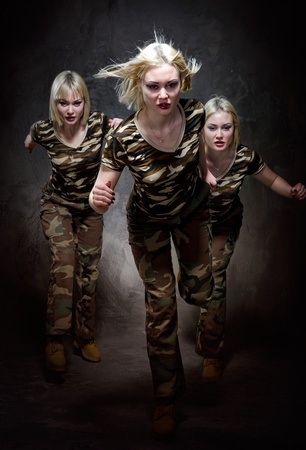 camouflage woman: Running military women isolated on black background  Stock Photo