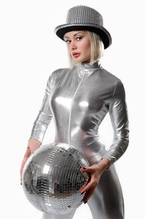 Beautiful young woman with a disco ball isolated on white photo