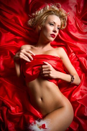 Gorgeous sensual blond woman lying in a bed Stock Photo - 8774195