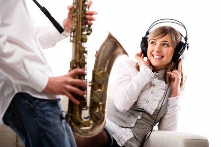 Lovely girl in headphones listening music  photo