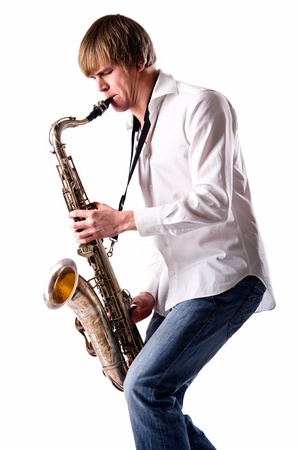 Young man with saxophone over white background  photo