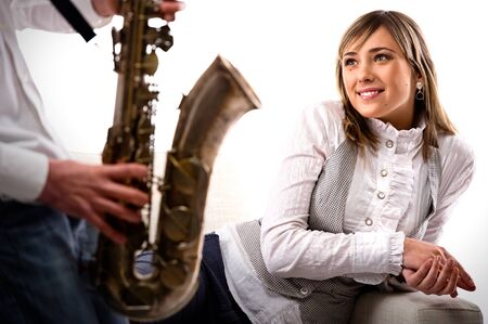 Man plays the saxophone for lovely girlfriend photo