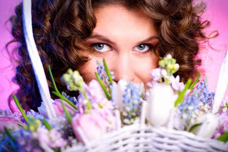 Attractive brunette with a bouquet of flowers close-up Stock Photo - 8975261