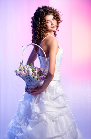 Beautiful bride with a bouquet of flowers photo
