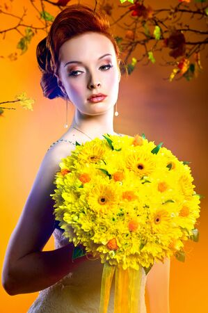 Gorgeous young redhead woman with bouquet of flowers  photo