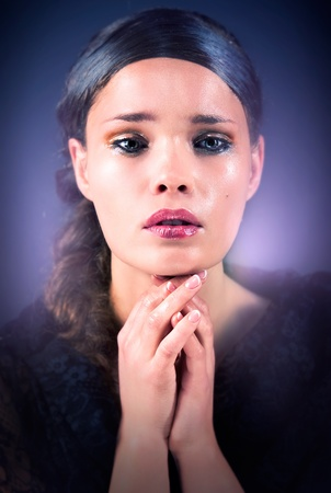 Young woman praying Imagens