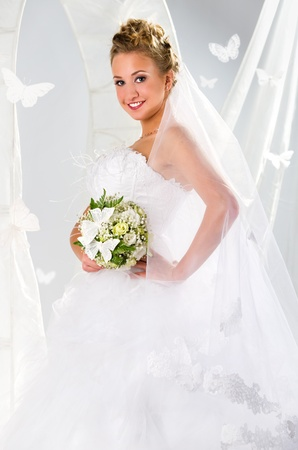 Beautiful bride with bouquet of flowers over summer background Stock Photo - 9257411