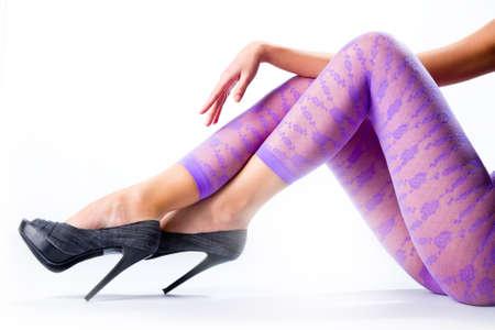 Female legs in purple leggings and high heels Stock Photo - 9225651