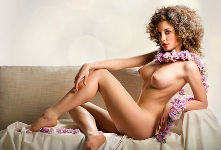 Beautiful naked young woman indoors Stock Photo