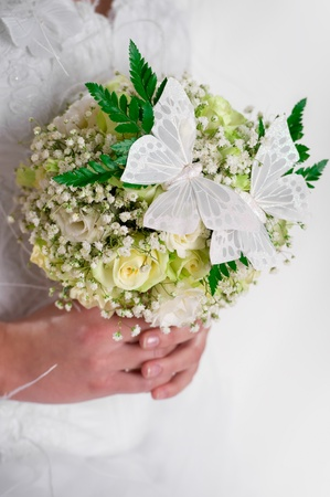 Beautiful bridal bouquet decorated with butterflies photo