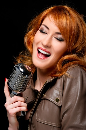 Beautiful redhead woman singing photo