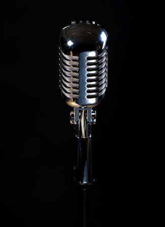 Professional vintage microphone isolated on black background  photo