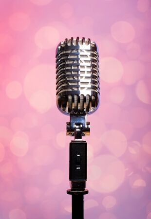 Professional vintage microphone over abstract background photo