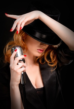 Redhead singer over black background photo