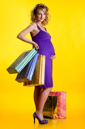 Lovely pregnant woman holding shopping bags  photo