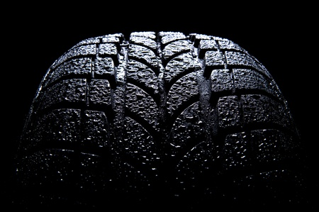 Car tire isolated on black background  photo