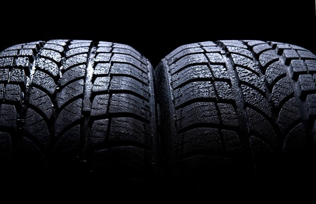 Car tires isolated on black background  Stock Photo - 9653133