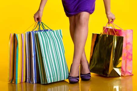 bargaining: Female hands holding shopping bags
